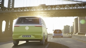 a car parked on the side of a building: VW Microbus Slated For Fully Electric Return in 2022
