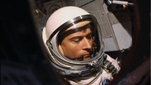 a man wearing a helmet: NASA Astronaut John Young Dies At 87