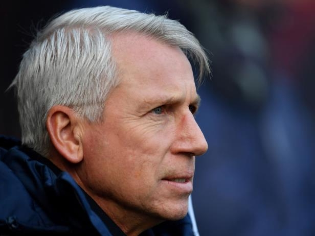 Alan Pardew looking at the camera: Getty