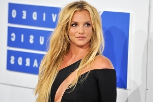 Britney Spears Frolics on the Shore in a Bikini in Playful Beach Video