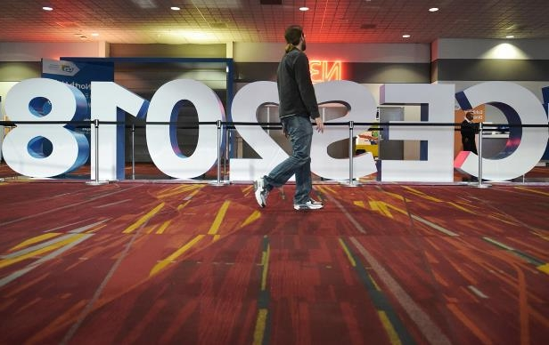 A man walks past a sign for the 2018 Consumer Electronics Show at the Las Vegas Convention Center in Las Vegas.