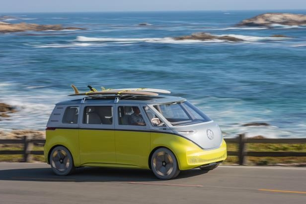 a yellow car parked on a beach: Volkswagen's I.D. Buzz prototype, which will use Nvidia's AI