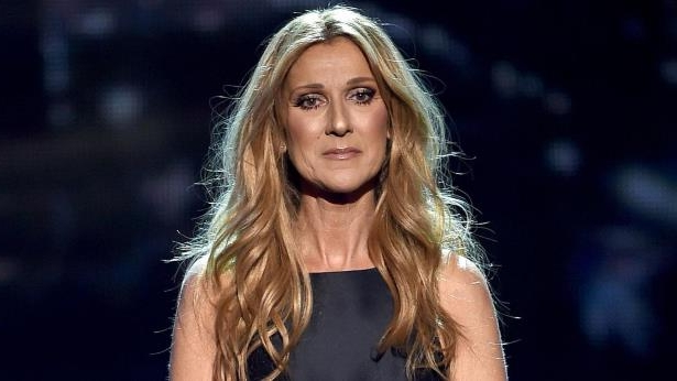 Celine Dion smiling for the camera