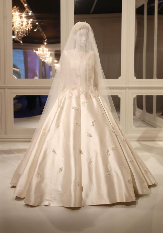 Slide 16 of 27: MELBOURNE, AUSTRALIA - AUGUST 25: Miranda Kerr's custom-made Christian Dior Couture wedding dress after she married Evan Spiegel is seen on display during a media preview of The House of Dior: Seventy Years of Haute Couture exhibition at NGV International on August 25, 2017 in Melbourne, Australia. (Photo by Scott Barbour/Getty Images)