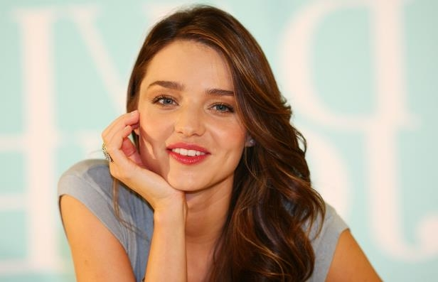 Slide 9 of 27: SYDNEY, AUSTRALIA - AUGUST 29: Miranda Kerr poses during an in-store promotional event promoting her Kora skin care range at the David Jones Castlereagh Street store on August 29, 2011 in Sydney, Australia. (Photo by Don Arnold/WireImage)