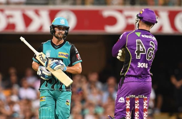 Hurricanes wicket keeper Matthew Wade (left) looks on as Heat player Alex Ross departs after being given out for obstruction during the men's Big Bash League cricket match between the Brisbane Heat and Hobart Hurricanes at the Gabba.