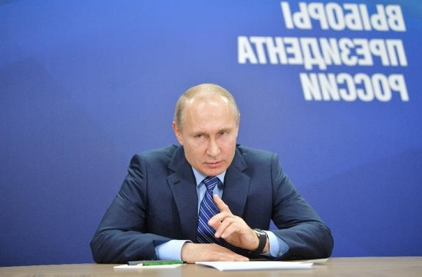 Russian President Vladimir Putin visits his election campaign office in Moscow. Putin, who is widely expected to win a fourth term in the March election, promised on Wednesday to hike the minimum wage.