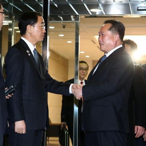 The head of North Korean delegation Ri Son Gwon, center left, shakes hands with South Korean Unification Minister Cho Myoung-gyon as he leaves the North side after their meeting at the Panmunjom in the Demilitarized Zone in Paju, South Korea, Tuesday, Jan. 9, 2018.: South Korea Koreas Tensions