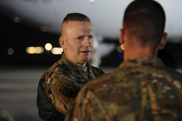 a man looking at the camera: U.S. Army Command Sgt. Maj. John W. Troxell, the senior enlisted adviser to Gen. Joseph F. Dunford, the chairman of the Joint Chiefs of Staff, speaks on the flightline of Al Dhafra Air Base in the United Arab Emirates on Dec. 22, 2017.
