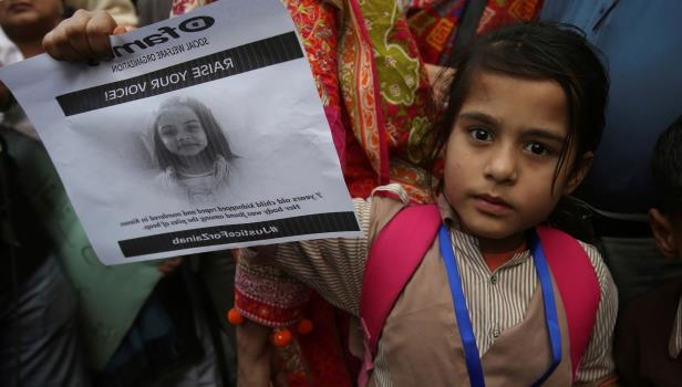 During a protest in Karachi, Pakistan, on Thursday, a girl holds a picture of Zainab Ansari, who police say was kidnapped, raped and killed in Kasur.