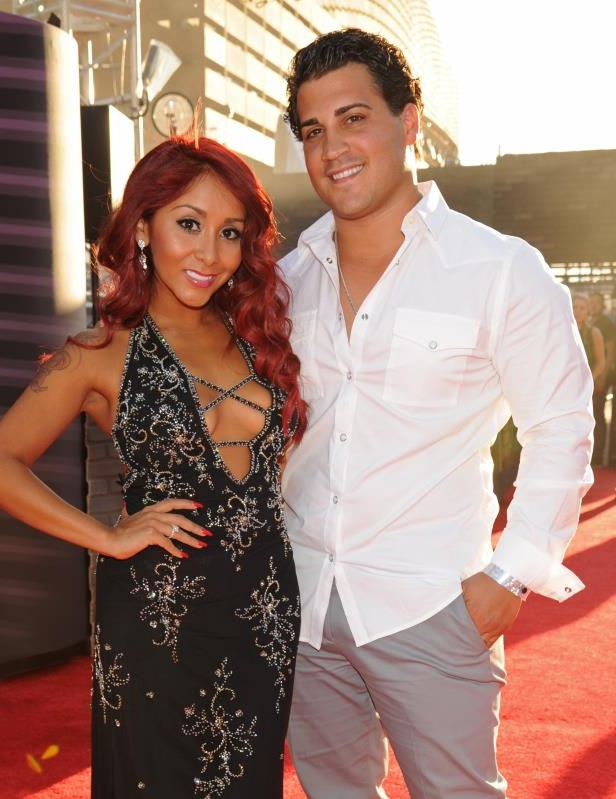 Nicole 'Snooki' Polizzi et al. posing for the camera: Nicole Polizzi (Snooki) and Jionni LaValle attend the MTV Video Music Awards in New York on Aug. 25, 2013.