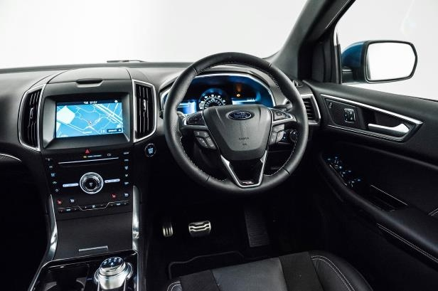 Slide 40 of 61: 2019-Ford-Edge-ST-front-interior-drivers-side.jpg
