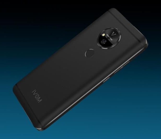 a close up of a device: The Movi phone is an Android device with a built-in projector