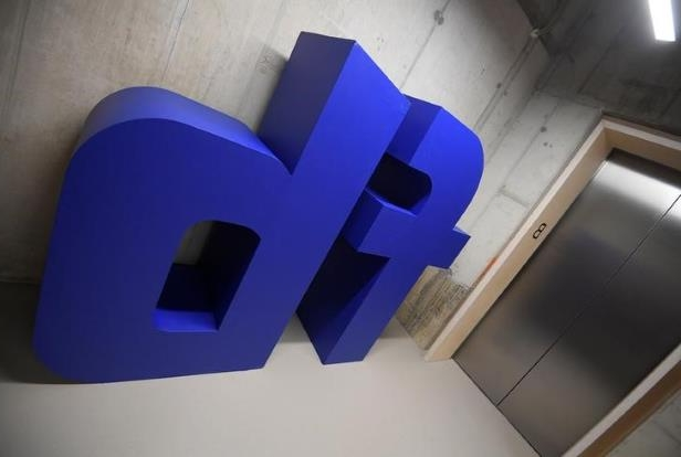 a close up of a logo: FILE PHOTO: A giant logo is seen at Facebook's headquarters in London