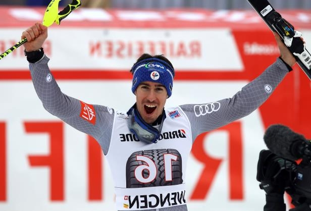 France's Victor Muffat-Jeandet celebrates at the finish line of an alpine ski, men's World Cup combined race, in Wengen, Switzerland, Friday, Jan.12, 2018. (AP Photo/Alessandro Trovati)