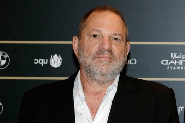 Harvey Weinstein wearing a suit and tie