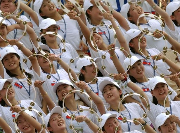 North Korean cheerleaders make a wave during their team's 2003 women's football match against Germany, in Gimcheon