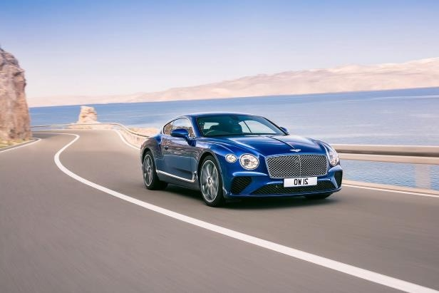 Slide 11 of 36: 2019-Bentley-Continental-GT-front-three-quarter-in-motion-02.jpg