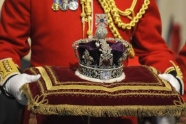 a person standing in front of a birthday cake: New Documentary Reveals the Surprising Place the Queen's Crown Jewels Were Hidden During WWII