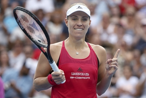 Angelique Kerber of Germany celebrates her win over Ash Barty of Australia in their women's final singles match at the Sydney International tennis tournament in Sydney, Saturday, Jan. 13, 2018.