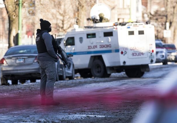 Police guard the scene of an incident on Saturday, Jan. 6, 2018 in the 6700 block of South Champlain Avenue in Chicago, Ill. (Lou Foglia/Chicago Tribune/TNS)