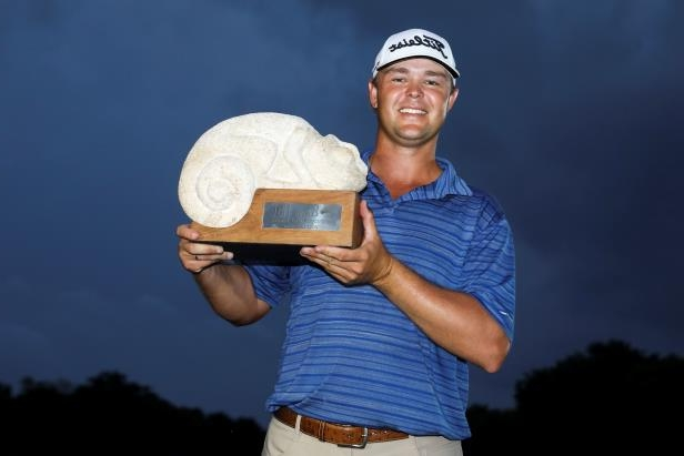 Slide 3 of 52: Patton Kizzire of the United States celebrates with the trophy on the 18th green after winning during the final round of the OHL Classic at Mayakoba on Nov. 12 in Playa del Carmen, Mexico.