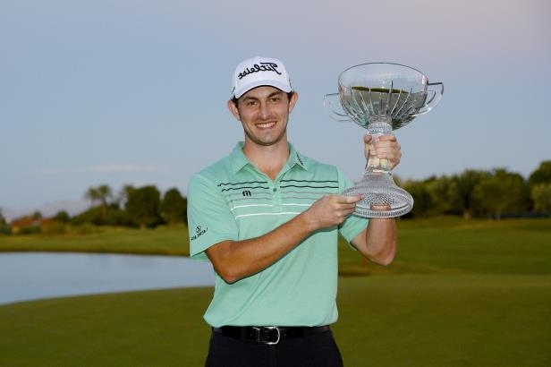 Slide 4 of 52: Patrick Cantlay poses with the winner's trophy after winning the Shriners Hospitals For Children Open at the TPC Summerlin on November 5, 2017 in Las Vegas, Nevada.