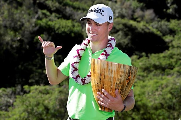 Slide 49 of 52: Justin Thomas holds the champions trophy after the final round of the Tournament of Champions golf event, Sunday, Jan. 8, 2017, at Kapalua Plantation Course in Kapalua, Hawaii. Thomas finished -22 under par for the win.