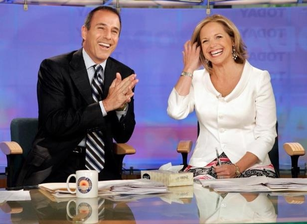 Katie Couric, Matt Lauer sitting at a table