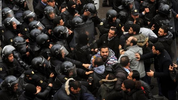 Protesters and security forces face off outside government offices on Friday January 12.