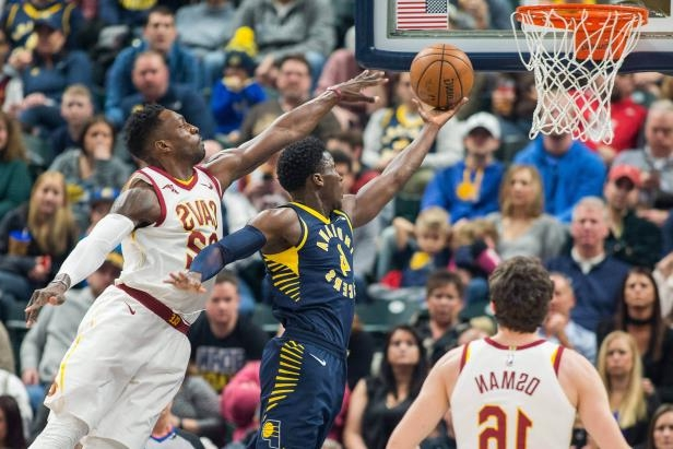 Slide 10 of 76: Indiana Pacers guard Victor Oladipo (4) shoots the ball while Cleveland Cavaliers forward Jeff Green (32) defends in the first half on Jan. 12 in Indianapolis, IN.