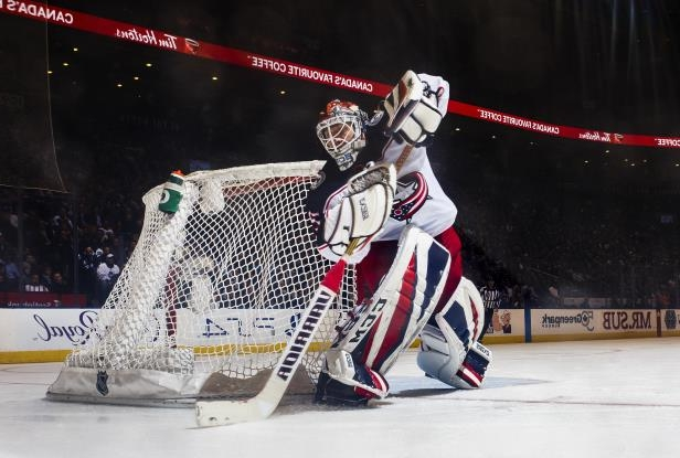 Slide 19 of 76: TORONTO, ON - JANUARY 8: Sergei Bobrovsky #72 of the Columbus Blue Jackets handles the puck against the Toronto Maple Leafs during the third period at the Air Canada Centre on January 8, 2018 in Toronto, Ontario, Canada. (Photo by Mark Blinch/NHLI via Getty Images)