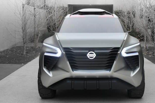 a car parked in a parking lot: 2018 Nissan Xmotion Concept Exterior Front Grille 02