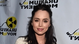 Eliza Dushku holding a sign: Eliza Dushku Alleges True Lies Stuntman Molested Her When She Was Just 12