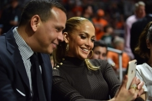Jennifer Lopez Steals a Kiss From Alex Rodriguez Courtside: Pics!