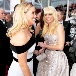 a group of people posing for the camera: Anna Faris and Reese Witherspoon attend the 87th Annual Academy Awards at Hollywood & Highland Center in Hollywood, California.