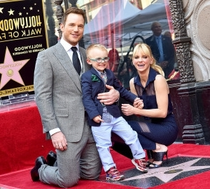 a group of people posing for the camera: Anna Faris, Chris Pratt and their son Jack attend the ceremony honoring Chris Pratt with a star on the Hollywood Walk of Fame on April 21, 2017 in Hollywood, California.