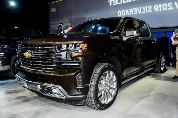 Slide 1 of 123: 2019-Chevrolet-Silverado-1500-High-Country-front-side-view-on-stage.jpg