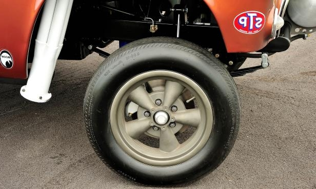 Slide 11 of 31: 011-jard-1955-ford-thunderbird-gasser-front-tire-wheel.jpg