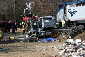 Train crash investigation focusing on truck driver's actions