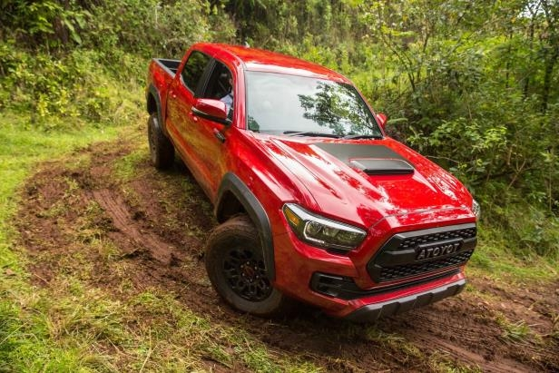 Slide 49 of 87: 2017-Toyota-Tacoma-4x4-TRD-Pro-front-three-quarter-off-road-down-hill.jpg