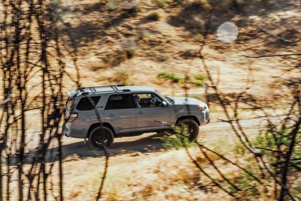 Slide 5 of 87: 2017-Toyota-4Runner-TRD-Pro-side-in-motion.jpg