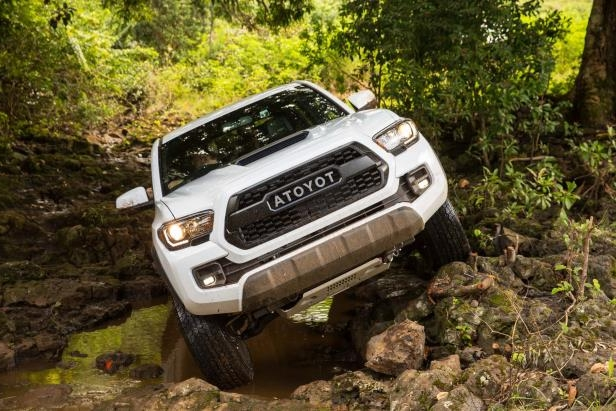 Slide 60 of 87: 2017-Toyota-Tacoma-4x4-TRD-Pro-front-end-off-road.jpg