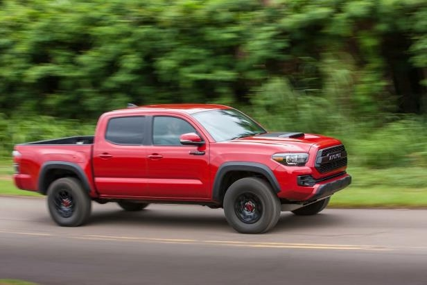 Slide 66 of 87: 2017-Toyota-Tacoma-4x4-TRD-Pro-side-in-motion.jpg