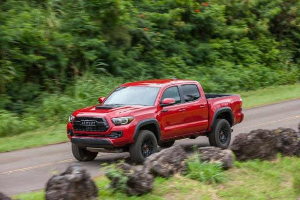 Slide 67 of 87: 2017-Toyota-Tacoma-4x4-TRD-Pro-side-in-motion-03.jpg