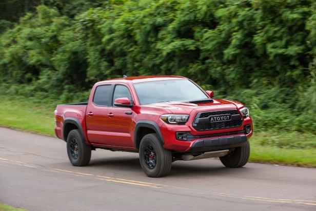 Slide 70 of 87: 2017-Toyota-Tacoma-4x4-TRD-Pro-front-three-quarters-in-motion.jpg