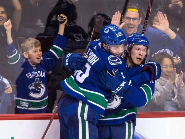 020418-HKN_Lightning_Canucks_20180203: Brock Boeser gets a hug from Bo Horvat after scoring his 25th goal of the season Saturday.<br />