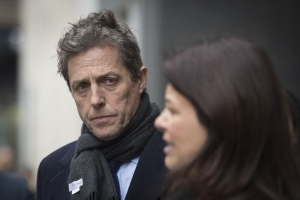 Actor Hugh Grant settles phone-hacking case with UK papers