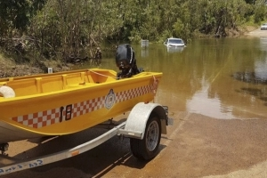 Woman rescued from floodwaters as wet weather continues across the Top End