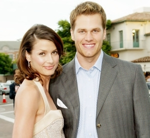 a person standing posing for the camera: Tom-Brady-and-Bridget-Moynahan
